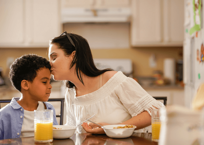 Mom and son eating breakfast together