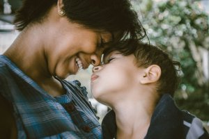 Mother and son looking happy and lovingly at each other. You can get the help your child needs to deal with trauma with EMDR therapy for kids in Scotch Plains, NJ. Start EMDR for children here with online therapy in New Jersey. We can do virtual EMDR therapy too!