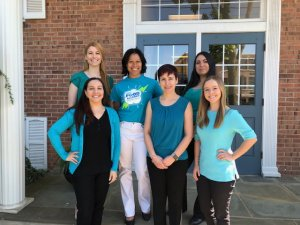 Six women in front of a building for Brave Minds Psychological Services. Online therapist in New Jersey help with anaphylactic reaction, providing food allergy therapy in Westfield, NJ
