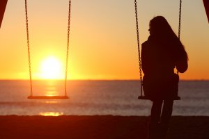 Woman on a swing looking at the sunset. Anxious women can get CBT Therapy Westfield, NJ at Brave Minds Psychological Services in Scotch Plains, NJ