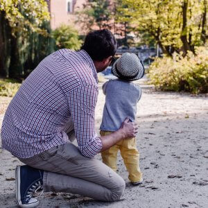 Father and son looking at something outside on the street, through the trees. The father feels more confident after working with a child psychologist in Scotch Plains, NJ for parenting advice and parent coaching. You can get parent counseling to compliment child therapy in union county nj or with online child therapy in New Jersey.