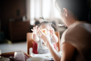 woman playing with her tiny child at the table. Can food allergies cause panic attacks? Yes! That's why anxiety therapy new jersey is great for parents of children and teens with food allergies new jersey. Westfield NJ counseling can help you cope with an anaphylactic reaction new jersey now.