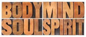 body, mind, soul and spirit - a collage of isolated words in vintage wood letterpress printing blocks, holistic wellness. Trauma therapy in Scotch Plains, NJ at Brave Minds Psychological Services Counseling Clinic for PTSD Treatment in Scotch Plains, NJ and in online therapy in New Jersey