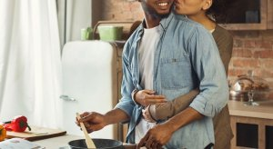 Woman standing behind their partner has her arms wrapped around him. He are looking to the side as he cooks something in the frying pan, and she kisses his cheek. Not every day may be as happy as this one, but Brave Minds Psychological Services offers couples counseling in scotch plains, nj, and couples therapy in westfield, nj. Contact us today for support with your relationship issues.