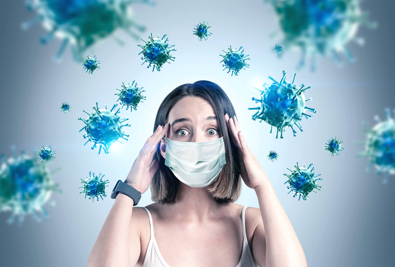 Scared young woman in medical mask standing over gray background with blurry red virus molecules. Coronavirus or COVID has an effect on postpartum in a pandemic. You can get birth trauma therapy or postpartum depression counseling in Cranford, NJ. Scotch Plains and Westfield, New Jersey 07076