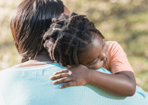 Parent comforts anxious child before an oral food challenge. Normalizing food allergy anxiety in children. You can get food allergy parenting therapy and teletherapy in Westfield, NJ and Cranford, NJ with Brave Minds in Scotch Plains, NJ