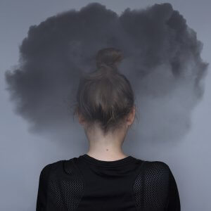 Woman with a dark cloud around her head after EMDR therapy with a client suffering from PTSD in Scotch Plains, NJ. You can get help for trauma therapy from a skilled online therapist in New Jersey with a Scotch Plains, NJ therapist here!