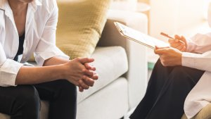 A therapist with a clipboard talks as a client listens. This could represent anxiety counseling in Scotch Plains, NJ. Contact a therapist for support with anxiety and rage. We offer equestrian related trauma therapy and other services.