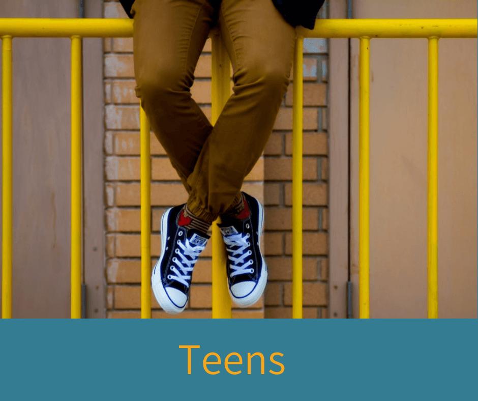 Teen sitting on a railing