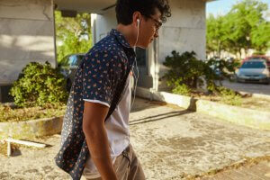 A lone teen walks with hands in pockets while listening to music with earbuds. Counseling for teens in Scotch Plains, NJ can provide online therapy for teens, in-person services, and more. Contact a teenage anxiety therapist for more information.