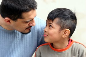 A father and son smile at one another as they talk. This represents the support anxiety counseling in Scotch Plains, NJ can offer support with child therapy for anxiety. Contact a child therapist today for more information about anxiety treatment!