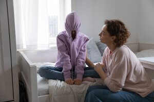 A mother talks to her upset teen daughter. Parenting counseling in Scotch Plains, NJ can offer support with child therapy for anxiety, parent coaching, and other services.