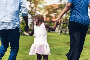 African American family walk in the park while holding hands. Parent counseling in Scotch Plains, NJ can offer support in combating rape culture. Learn more about sexual violence support in Scotch Plains, NJ today. Parenting help in westfield, NJ can help you and your child today!