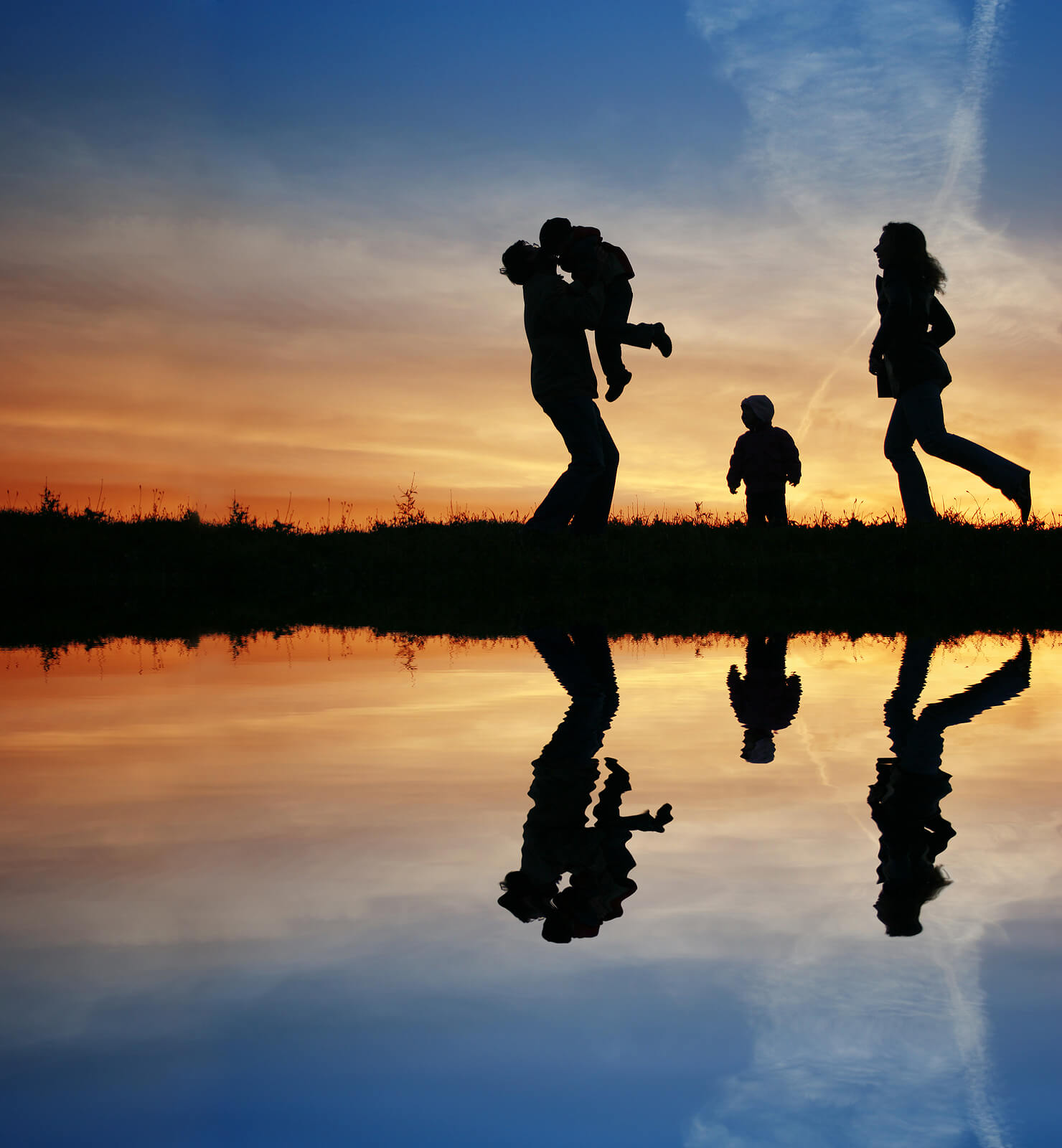 A silhouette of a family walk across the water as the sun rises. Contact brave minds psychological services to learn more about sexual violence prevention in Scotch Plains, NJ, parent counseling in Scotch Plains, NJ and other services.