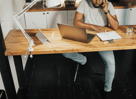 A man focuses on a laptop for Brave Minds. We offer therapy for perfectionism in Scotch Plains, NJ, anxiety counseling, and other services. Contact a perfectionism therapist today for more info!